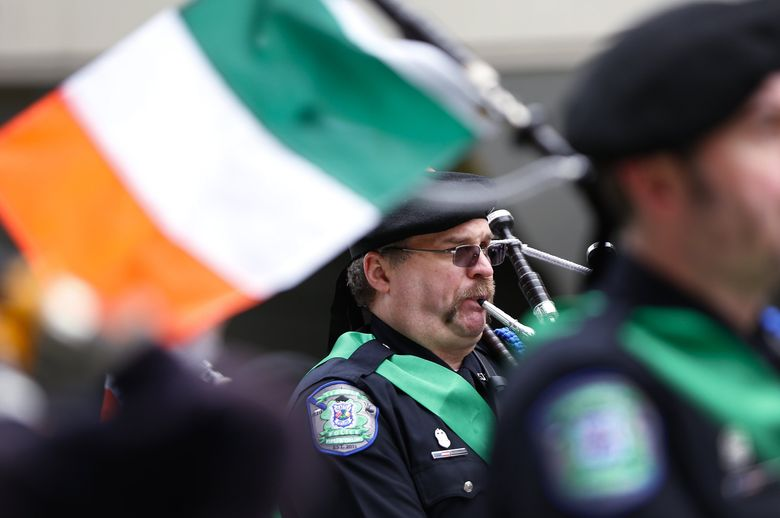 The Seattle Police Pipes and Drums, shown here in 2014, will march again Saturday, March 12, in the annual St. Patrick's Day Parade down Fourth Avenue.  (LINDSEY WASSON/The Seattle Times)