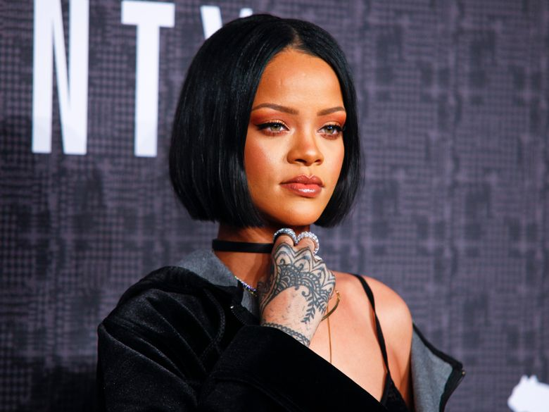 FILE – In this Feb. 12, 2016, file photo, Rihanna attends the JFENTY PUMA by Rihanna fashion show in New York. Rihanna will receive the Rock Star Award at the annual event honoring black women, BET announced Monday, March 14. (Photo by Andy Kropa/Invision/AP, File)