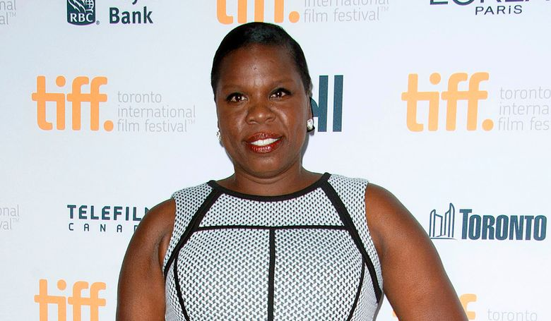 """FILE – In this Sept. 6, 2014, file photo, actress Leslie Jones poses at the """"Top Five"""" premiere at the Princess of Wales Theatre during the Toronto International Film Festival in Toronto. Jones, of the upcoming all-female version of """"Ghostbusters,"""" took to Twitter to defend her role as a member of the paranormal-fighting group who appears in footage released this week to be an employee of the Metropolitan Transportation Authority. (Photo by Arthur Mola/Invision/AP, File)"""