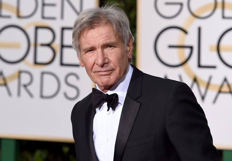 """FILE – In this Jan. 10, 2016 file photo, Harrison Ford arrives at the 73rd annual Golden Globe Awards at the Beverly Hilton Hotel in Beverly Hills, Calif. """"Indiana Jones"""" is swinging back into theaters with Harrison Ford reprising the iconic role and Steven Spielberg directing. Warner Bros. announced Tuesday, March 15, 2016 that the fifth film in the series will open July 19, 2019.(Photo by Jordan Strauss/Invision/AP)"""