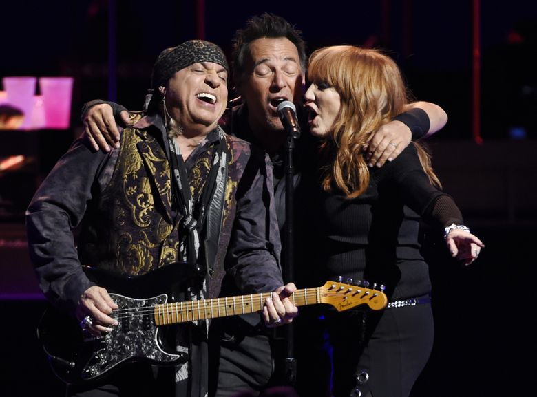 Bruce Springsteen, center, performs with Steven Van Zandt, left, and Patti Scialfa of the E Street Band during their March 15 concert in Los Angeles. Springsteen will perform in Seattle on March 24.  (Chris Pizzello/Chris Pizzello/Invision/AP)