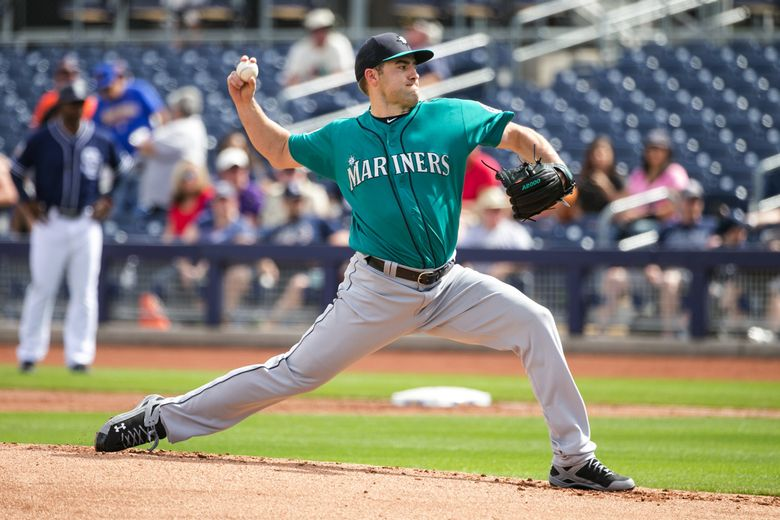 Mariners pitcher Nathan Karns throws in the first inning against the the Padres on March 18. (Bettina Hansen/The Seattle Times)