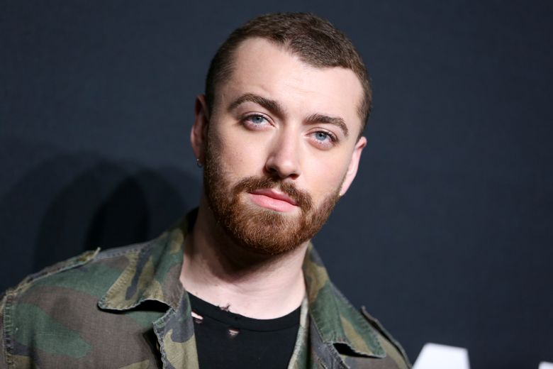 FILE – In this Feb. 10, 2016 file photo, Sam Smith arrives at Saint Laurent at the Palladium at the Hollywood Palladium in Los Angeles. Smith is currently working on his second album. (Photo by Rich Fury/Invision/AP)