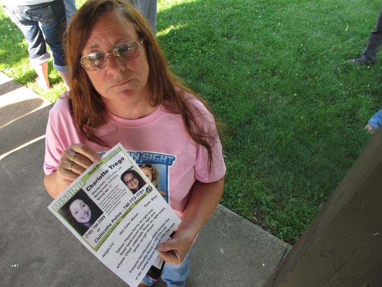 """FILE – In this June 24, 2015, file photo, Yvonne Boggs holds a flier seeking information on her daughter, Charlotte Trego, who has been missing for more than a year, in Chillicothe, Ohio. The Investigation Discovery network says it will air its first-ever serialized drama later this spring. The six-part docu-series, """"The Vanishing Women,"""" will focus on six women who have gone missing or been found dead in Chillicothe, Ohio, over the past few years. Missing women Trego and Wanda Lemons haven't been seen by loved ones since 2014. It will debut June 6, ID announced on Thursday, March 31, 2016. (AP Photo/Andrew Welsh-Huggins, File)"""