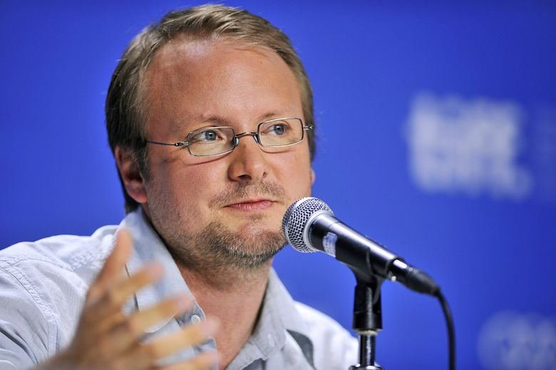 """FILE – In this Sept. 6, 2012 file photo, writer-director Rian Johnson speaks about his movie """"Looper"""" during a news conference at the 2012 Toronto International Film Festival in Toronto. A former agent for the director of the next """"Star Wars"""" film is suing claiming he was cut out of negotiations regarding the blockbuster franchise. Agent Brian Dreyfuss sued  Johnson in Los Angeles Superior Court on Friday March 18, 2016, seeking 10 percent of the director's """"Star Wars"""" earnings. (AP Photo/The Canadian Press, Aaron Vincent Elkaim, File)"""