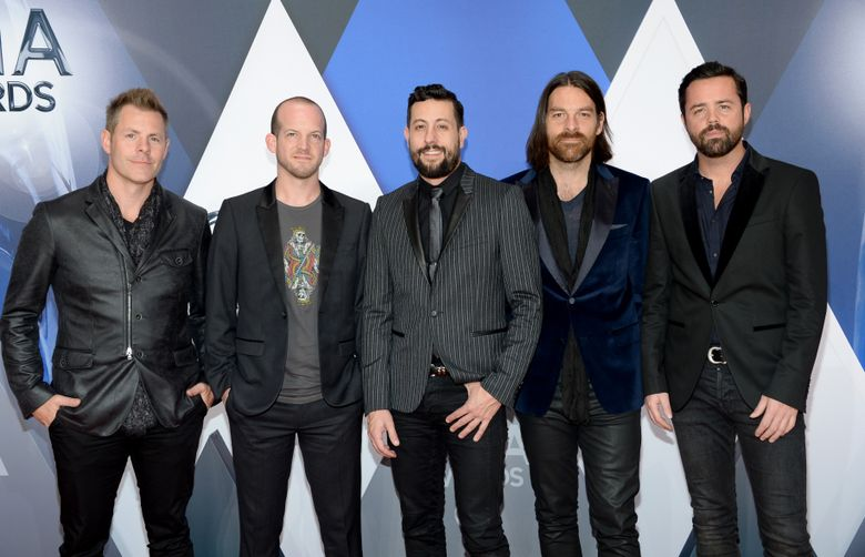 FILE – In this Nov. 4, 2015, file photo, members of Old Dominion, from left, Trevor Rosen, Whit Sellers, Matthew Ramsey, Geoff Sprung and Brad Tursi arrive at the 49th annual CMA Awards at in Nashville, Tenn. When members of the band saw their name on the voting ballots for the 51st Academy of Country Music Awards that will be held Sunday, April 3, 2016, for both new vocal duo/group of the year and vocal group of the year, the whole thing felt like a joke on them. (Photo by Evan Agostini/Invision/AP, File)