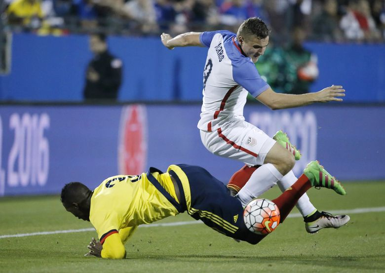 U.S. forward Jordan Morris, top, battles Colombia defender Yerry Mina (3) during the first half on Tuesday. (Brandon Wade/The Associated Press)