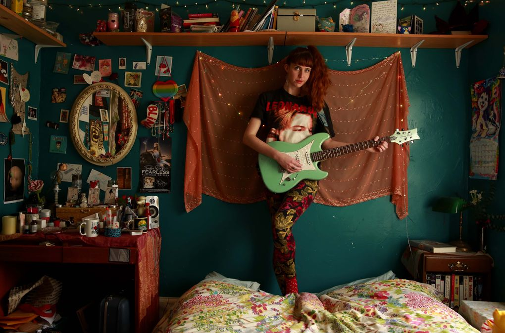 """Robin Edwards, aka Lisa Prank, 26, is shown in her bedroom at the Central District house she shares with other musicians. Originally from Denver, she describes her music as """"Trapper Keeper pop punk."""" Her new record, """"Adult Teen,"""" will be released in June.  (Erika Schultz/The Seattle Times)"""