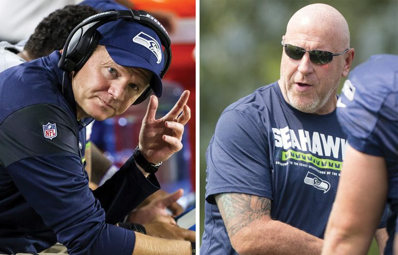 Former Seahawks coaches Darrell Bevell, left, and Tom Cable. (Bettina Hansen / The Seattle Times)