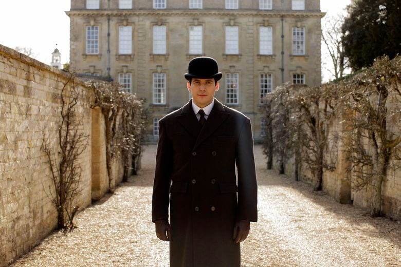 """This image released by PBS shows Robert James-Collier as Thomas from the final season of """"Downton Abbey."""" The series finale airs in the U.S. on Sunday. (Nick Briggs/Carnival Film & Television Limited 2015 for MASTERPIECE via AP)"""