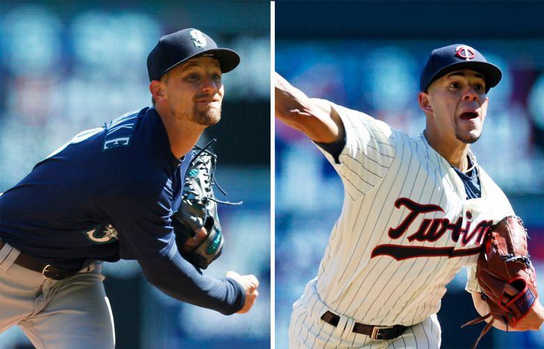 Mariners starter Mike Leake, left, and Twins starter Jose Berrios. (Jim Mone / Associated Press)