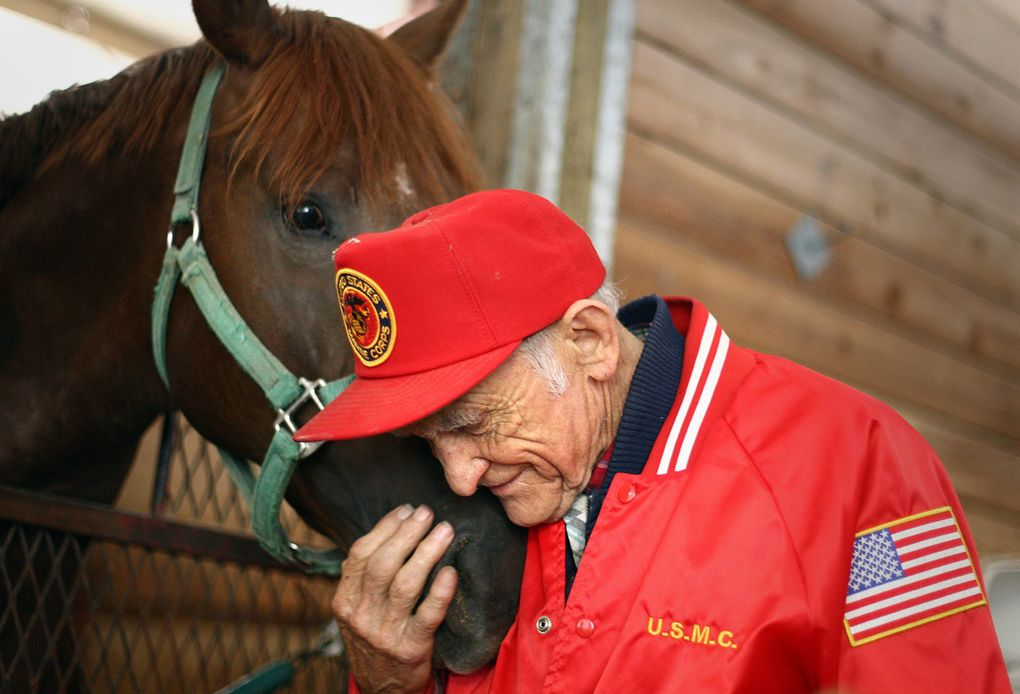 Don Munger, a longtime trainer at Emerald Downs, snuggles up to Boise Creek, a 2-year-old colt, on Aug. 4, 2009. (John Lok / The Seattle Times)