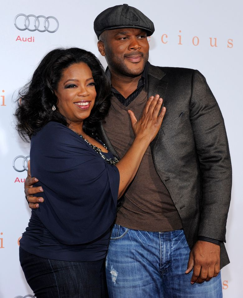 """FILE – In this Nov. 1, 2009 file photo, Oprah Winfrey, left, and Tyler Perry arrive at the premiere of the film """"Precious: Based on the Novel 'Push' by Sapphire,"""" at AFI Fest 2009 in Los Angeles. Perry has four shows on OWN; """"The Have and Have Nots"""" and  """"If Loving You Is Wrong,"""" and the comedies """"Love Thy Neighbor,"""" and """"For Better or Worse."""" The Have and the Have Nots"""" delivered huge ratings, setting records for the network. (AP Photo/Chris Pizzello, File)"""