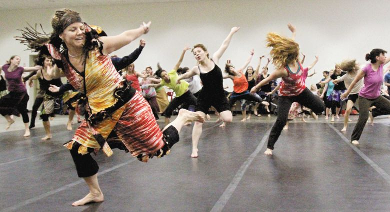 Sarah Lee Parker, left, leads a spirited class in West African dance at the World Rhythm Festival at Seattle Center in 2013. This year's festival runs Friday-Sunday, April 8-10.  (Alan Berner/The Seattle Times)