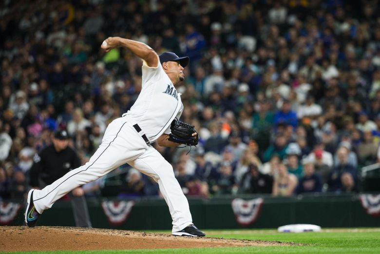 Pitcher Joel Peralta throws in the seventh inning at Safeco Field during Seattle's home opener Friday, April 8, 2016.  The Mariners, entering with a 2-1 record, started their home season against the Oakland Athletics with Taijuan Walker as the starting pitcher.