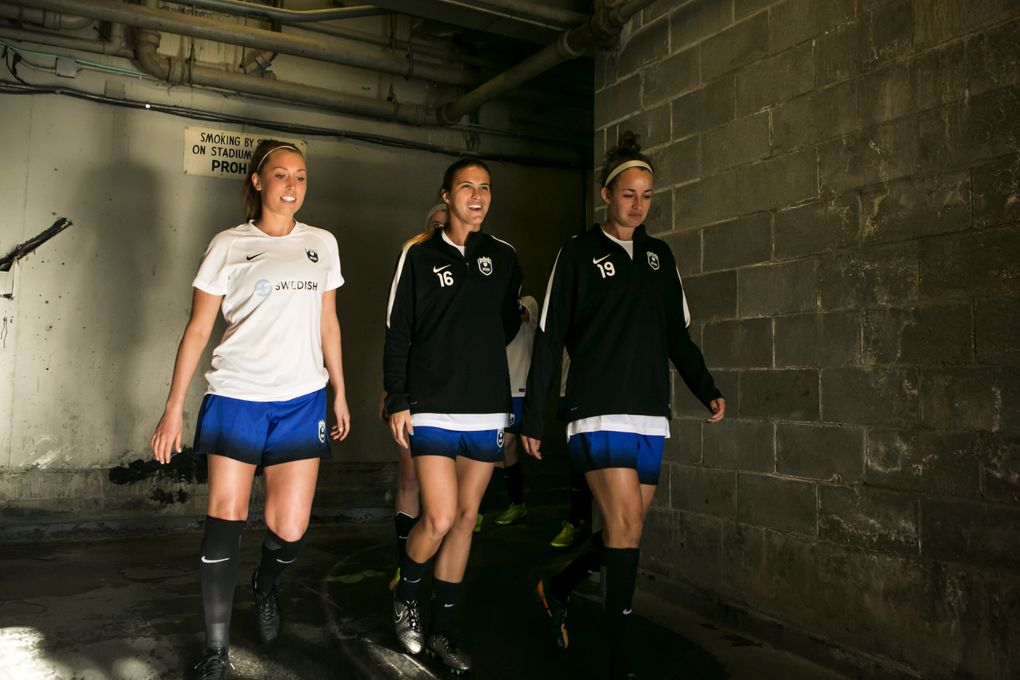 Rookie left back Carson Pickett, middle, starts with the Seattle Reign for a home preseason friendly against the University of Washington women's team on April 9, 2016.  (Bettina Hansen/The Seattle Times)