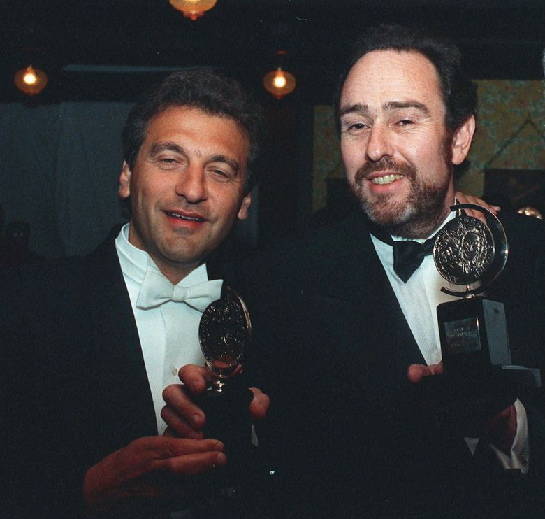 """FILE – In this June 8, 1987 file photo, Alain Boublil, left, and Claude-Michel Schonberg, the French creators of """"Les Miserables"""" hold two of the eight Tony awards won by the musical in New York. The duo are being celebrated Monday, May 2, 2016, with a star-filled concert at The New York Pops. (AP Photo/Ed Bailey, File)"""