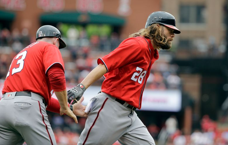 Washington Nationals' Jayson Werth, right, is congratulated by third base coach Bob Henley after hitting a three-run home run during the first inning of a baseball game against the St. Louis Cardinals Saturday, April 30, 2016, in St. Louis. (AP Photo/Jeff Roberson)