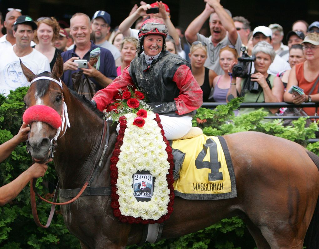 Wasserman (4), ridden by Jennifer Whitaker, celebrates in the winner's circle after coming from the outside to catch favored True Metropolitan (11) and Tropic Storm (2) at the wire in the Longacres Mile at Emerald Downs on Aug. 17, 2008. (Jim Bates / The Seattle Times)