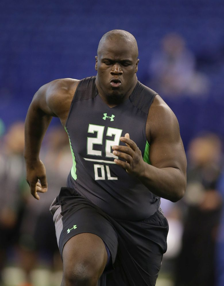 Texas A&M offensive lineman Germain Ifedi is nearly 6 feet 6 and could play right guard or right tackle for the Seahawks. (Darron Cummings/AP)