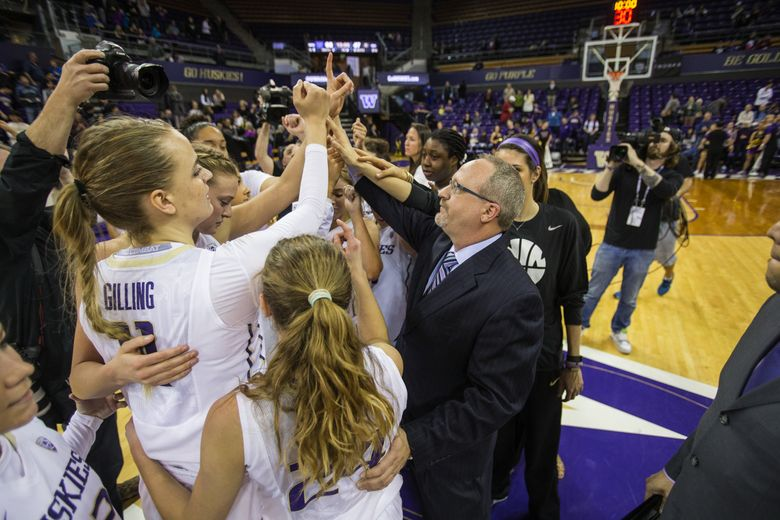 Mike Neighbors brings his Washington Huskies women's basketball team to midcourt following their win over Colorado in the regular-season finale. Only a No. 7 seed in the NCAA tournament, UW has advanced to the Final Four this weekend.  (Dean Rutz/The Seattle Times)