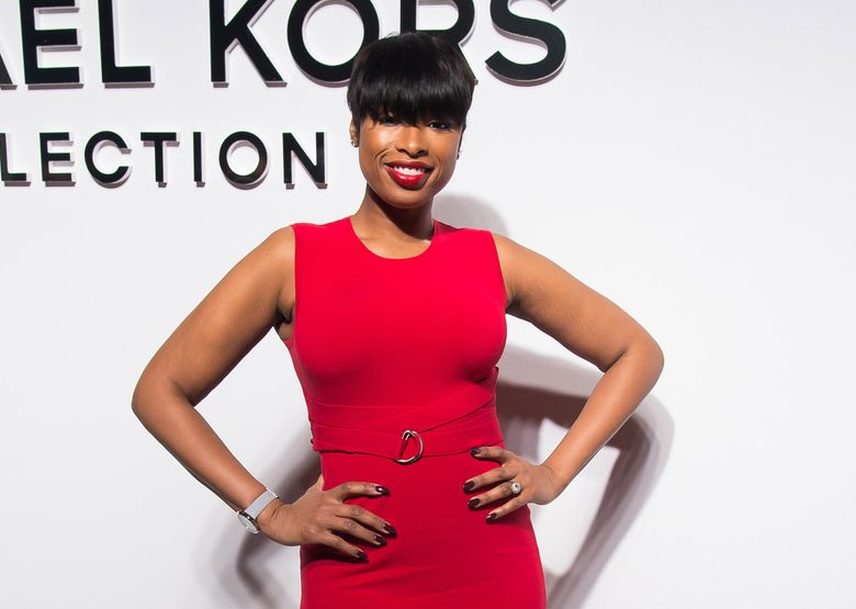 """FILE – In this Feb. 17, 2016 file photo, Jennifer Hudson attends the Michael Kors 2016 show during Fashion Week in New York. Hudson and Harvey Fierstein will headline the cast of NBC's """"Hairspray Live!"""" Based on the cult John Waters movie set in 1960s Baltimore, the show concerns the full-figured Tracy Turnblad whose fondest wish is to appear on a local television dance program. (Photo by Charles Sykes/Invision/AP, File)"""