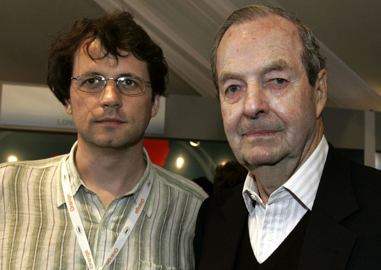 """FILE In this file photo, dated Saturday May 14, 2005, Frederick Baker, the Anglo-Austrian director of """"Shadowing The Third Man"""", left, and Britain's Guy Hamilton, director of four James Bond films, pose prior to their joint press conference at the 58th international Cannes film festival in Cannes, southern France. A hospital on his home island of Mallorca said he died aged 93 on Wednesday April 20, 2016. (AP Photo/Michel Euler, FILE)"""