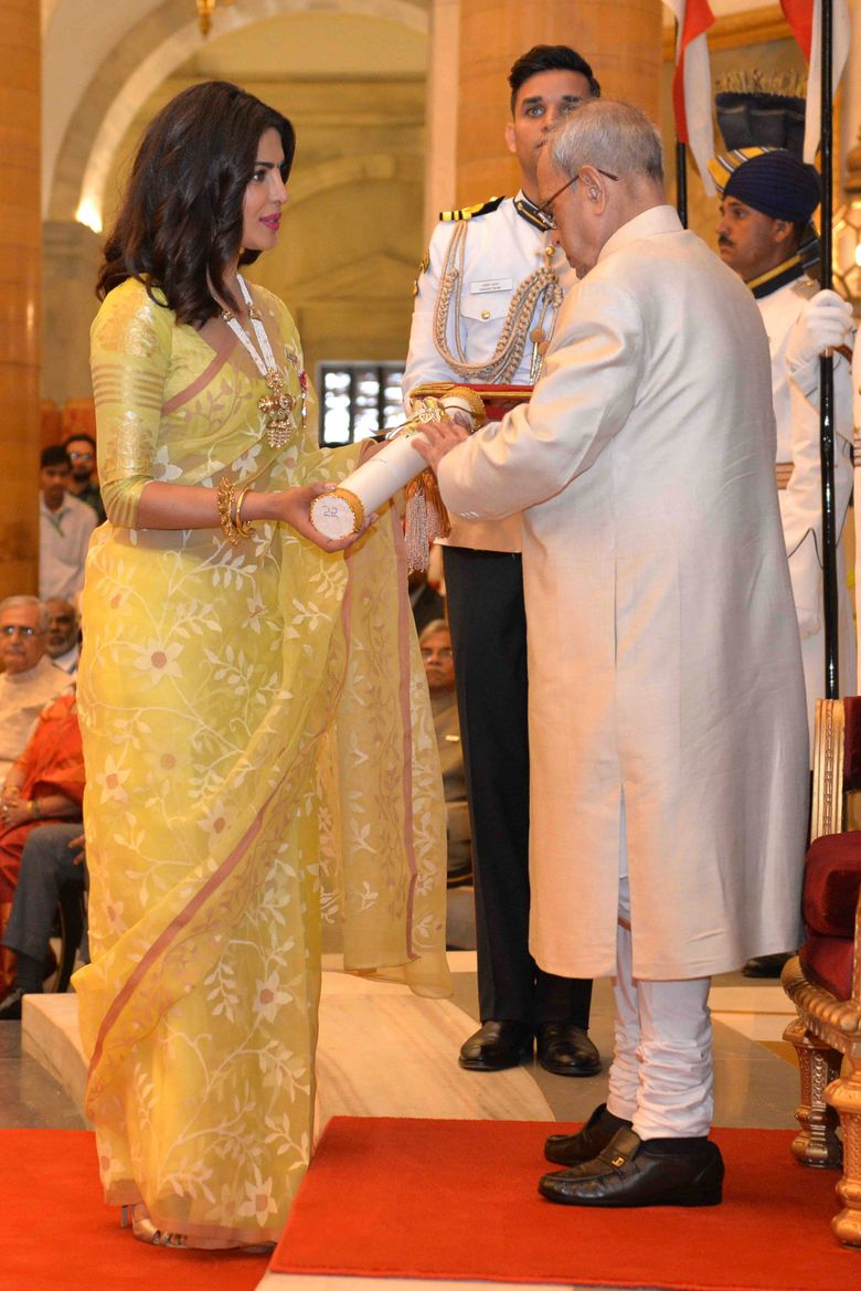 Indian Bollywood actor Priyanka Chopra, left, receives Padma Shri award from Indian President Pranab Mukherjee during civil investiture ceremony in New Delhi, India, Tuesday, April 12, 2016. Padma Shri is the fourth highest civilian award given to people for their distinguished contribution in various fields. (India Presidential Palace via AP)
