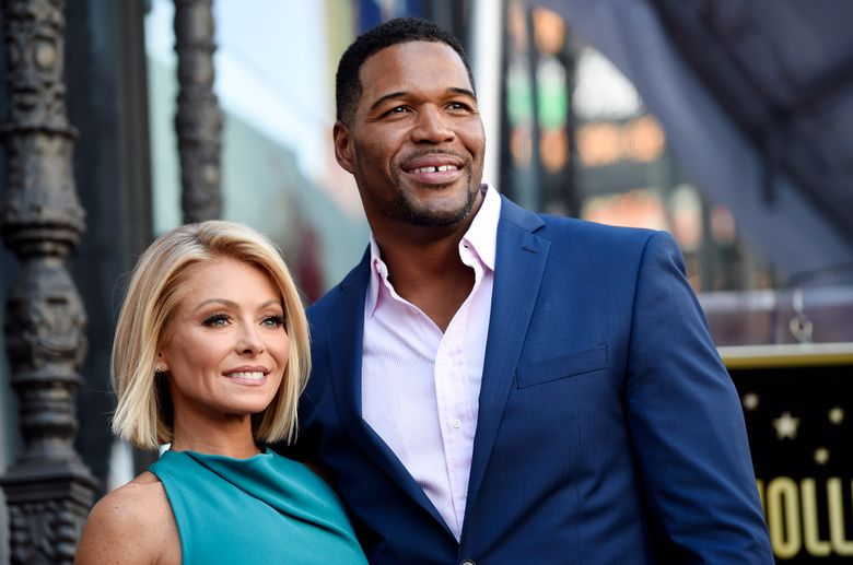"""FILE – In this Oct. 12, 2015 file photo, Kelly Ripa, left, poses with Michael Strahan, her co-host on the daily television talk show """"LIVE! with Kelly and Michael,"""" during a ceremony honoring Ripa with a star on the Hollywood Walk of Fame in Los Angeles. Ripa returns as co-host of the morning show after a four-day absence after ABC announced Tuesday that co-host Strahan will leave the show to join """"Good Morning America"""" full-time.   (Photo by Chris Pizzello/Invision/AP, File)"""