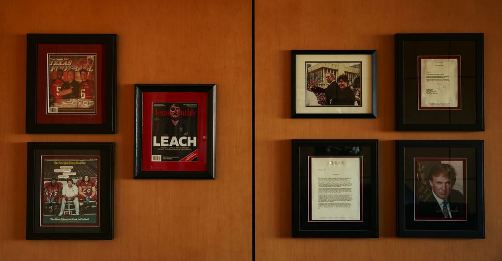 A framed photograph of Donald Trump and George W. Bush hangs in head football coach Mike Leach's office. (Erika Schultz/The Seattle Times)