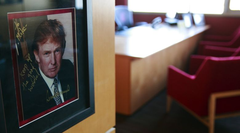 A framed photograph of Donald Trump hangs in head football coach Mike Leach's office at Washington State. (Erika Schultz/The Seattle Times)