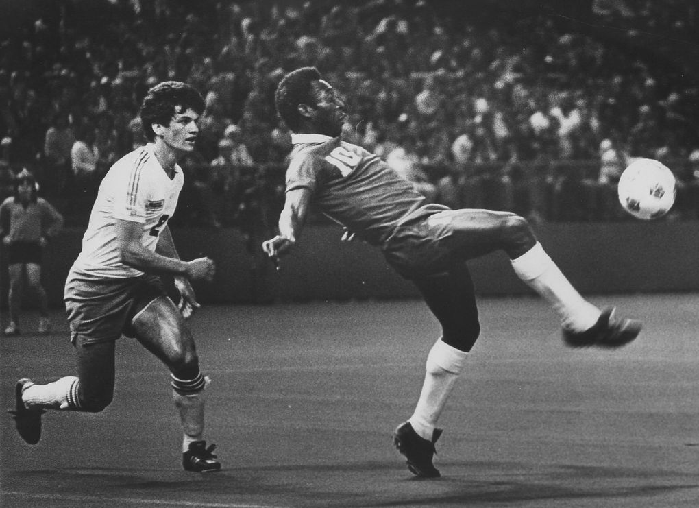 Pele put his world-famous toe to the ball during a 1976 exhibition match against the Sounders at the Kingdome. Following the ball was Seattle's Dave D'Errico. (Seattle Times file)
