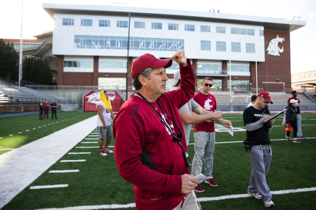 Football coach Mike Leach works during practice at Washington State. (Erika Schultz/The Seattle Times)