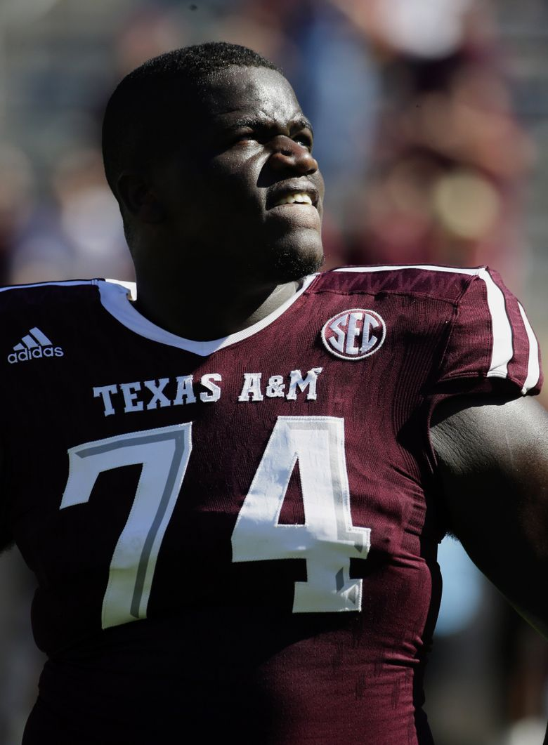 Texas A&M offensive lineman Germain Ifedi (74) waits to sing a school song before an NCAA college football game against Nevada Saturday, Sept. 19, 2015, in College Station, Texas. (David J. Phillip/AP)