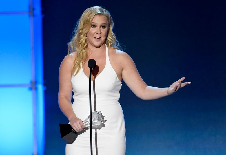 """FILE – In this Jan. 17, 2016 file photo, Amy Schumer accepts the Critics' Choice MVP award at the 21st annual Critics' Choice Awards in Santa Monica, Calif. Schumer took to Instagram and Twitter after learning that she was  included in a special edition of Glamour magazine aimed at the plus-size women's market. She questioned why she wasn't told of her inclusion and declared that the """"plus size"""" label was unnecessary in general.  (Photo by Chris Pizzello/Invision/AP, File)"""