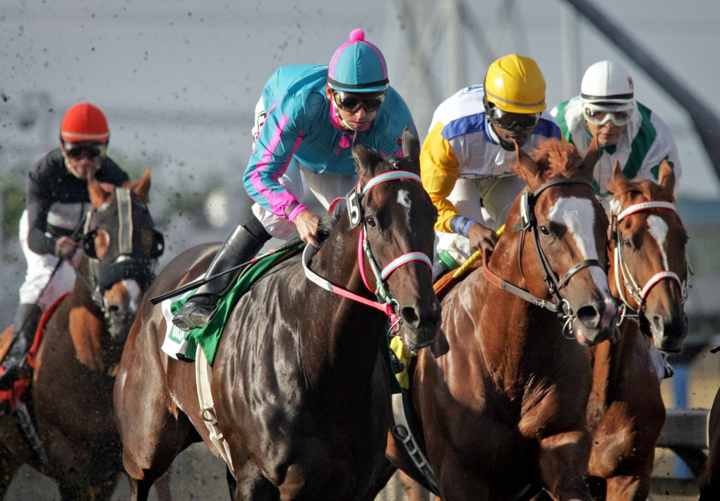 Jockey Ricky Frazier pulls out in front before the first turn during the Longacres Mile aboard 4-year-old Noosa Beach, owned by Jeff and Doris Harwood, at Emerald Downs on Aug. 22, 2010. It was the 75th running of the Longacres Mile. (Ellen M. Banner / The Seattle Times)