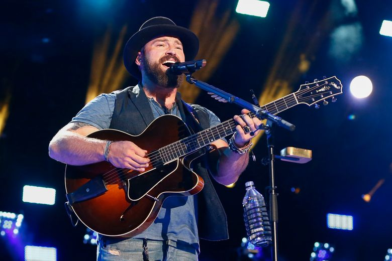 FILE – In this June 12, 2015 file photo, Zac Brown of the Zac Brown Band performs at LP Field at the CMA Music Festival in Nashville, Tenn. Brown said in a statement that he was in the wrong place at the wrong time at a Palm Beach hotel in which four people were arrested for drug possession. A report from Palm Beach Police Department showed that Brown was present when police arrived at the Four Seasons Hotel on April 8, but he was not charged or arrested.  (Photo by Al Wagner/Invision/AP, File)