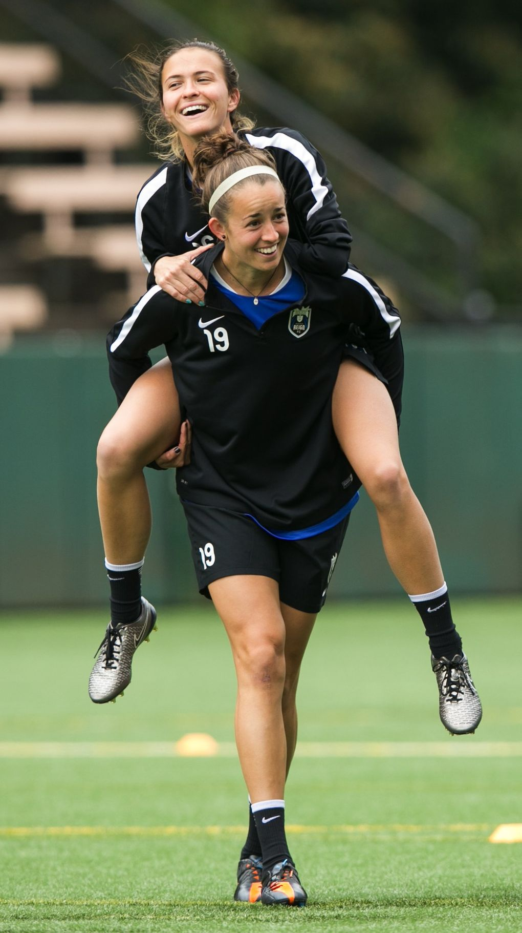 Seattle Reign defender Carson Pickett piggybacks on midfielder Havana Solaun during a fun drill at practice April 11, 2016. Pickett and Solaun are good friends — the two met while playing tennis as kids in Florida. (Bettina Hansen/The Seattle Times)