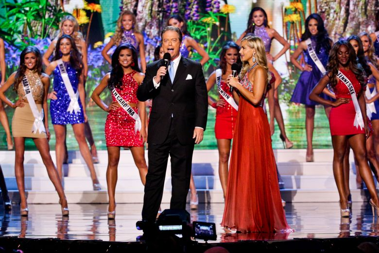 FILE – In this July 12, 2015 file photo, Miss USA co-host Todd Newton and former Miss Wisconsin USA 2009, Alex Weherley during the 2015 Miss USA pageant in Baton Rouge, La. The Miss Universe Organization said Wednesday, April 20, 2016, it will conduct an online search for a candidate to join the 51 contestants from all 50 states and the District of Columbia on the live telecast June 5 on Fox. (AP Photo/Derick E. Hingle, File)