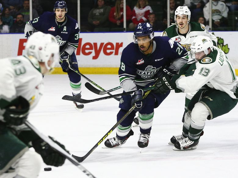 Seattle Thunderbirds right wing Keegan Kolesar drives against Everett Silvertips center Remi Laurencelle in game 3 of a best-of-seven series during the second round of the WHL playoffs at Xfinity Arena in Everett on Wednesday, April 13, 2016.  (Lindsey Wasson/The Seattle Times)