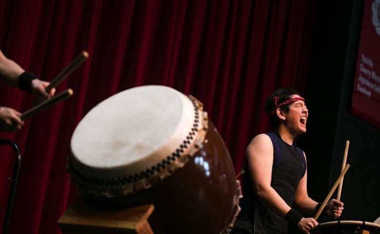 Garrett Nakawatase, one of the founding members of drumming group Inochi Taiko, performs in the Seattle Center Armory at last year's Seattle Cherry Blossom & Japanese Cultural Festival. (Bettina Hansen/The Seattle Times)