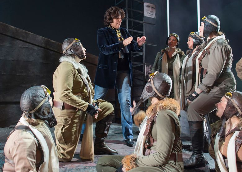 """This undated image released by the Washington National Opera shows Director Francesca Zambello speaking to the Valkyries, warrior maidens who in this production are dressed as modern-day airmen, during an onstage rehearsal for Wagner's """"Ring"""" cycle at the Washington National Opera. Zambello will direct Richard Wagner's """"Ring Cycle"""" at the Kennedy Center from April 30-May 22. (Scott Suchman/Washington National Opera via AP)"""