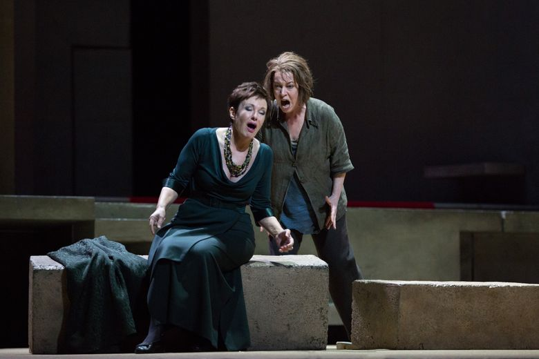 """This image released by the Metropolitan Opera shows Mezzo-soprano Waltraud Meier as Klytemnestra, left, and soprano Nina Stemme as her daughter Elektra, during a performance of Richard Strauss's """"Elektra"""" at the Metropolitan Opera in New York.  The matinee performance this Saturday will be broadcast live in HD to movie theaters worldwide. (Marty Sohl/Metropolitan Opera via AP)"""