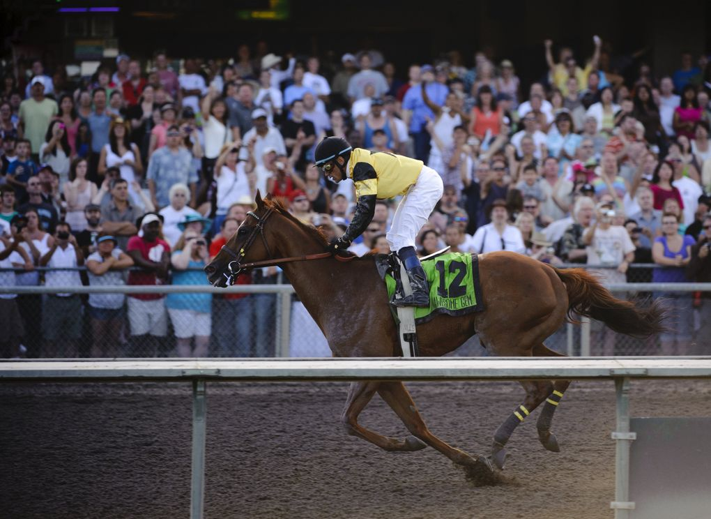 Awesome Gem, ridden by David Flores, passes the finish line to win the Longacres Mile on Aug. 21, 2011, at Emerald Downs. (Joel Hawksley / The Seattle Times)