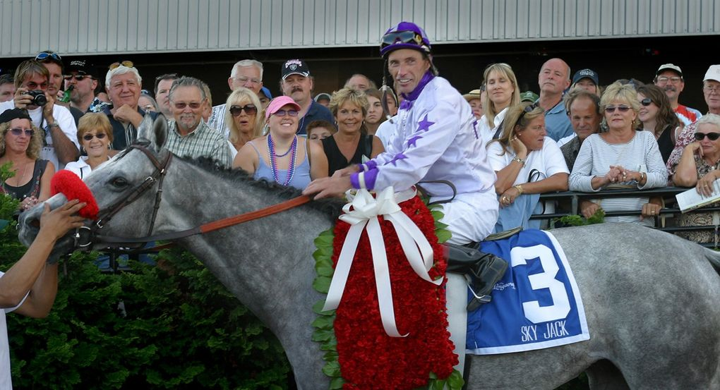 Jockey Russell Baze sits on Sky Jack after winning the Longacres Mile at Emerald Downs on Aug. 24, 2003. (The Seattle Times)