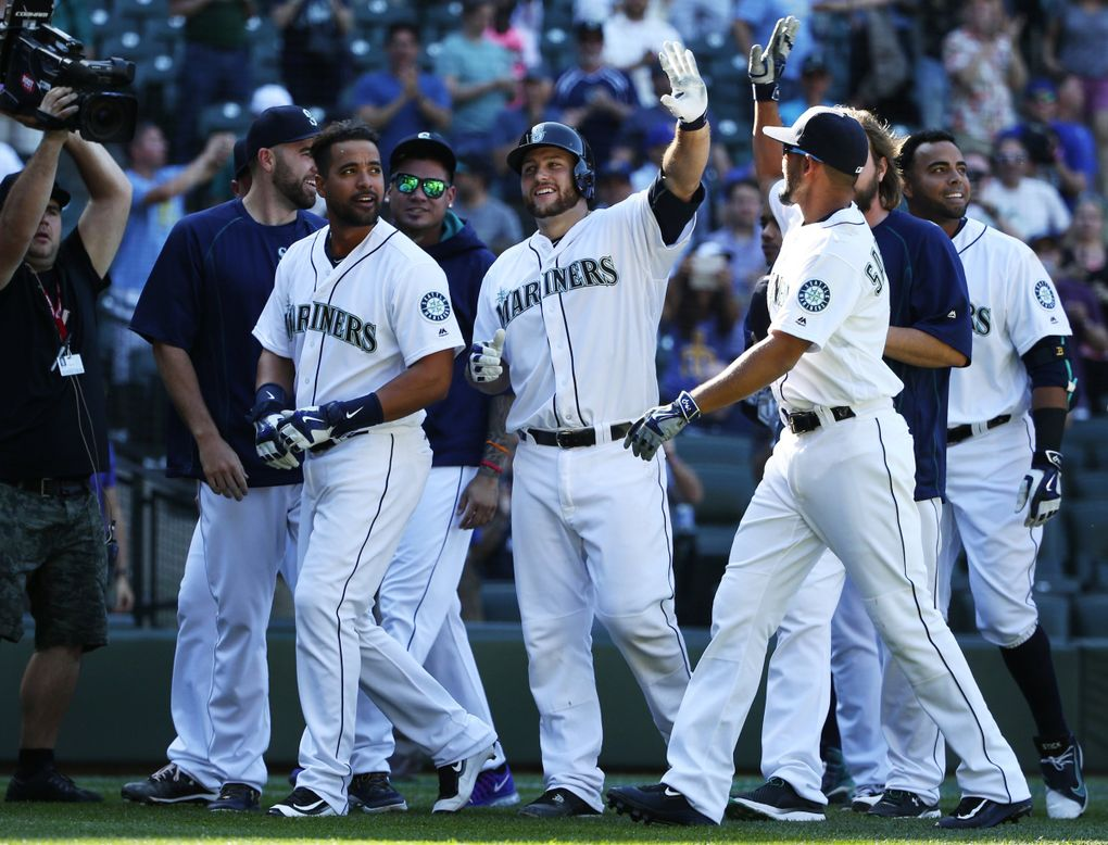Mariners catcher Chris Iannetta hit a walkoff homer in the 11th inning of a game against the Tampa Bay Rays on May 11. (Ken Lambert / The Seattle Times)