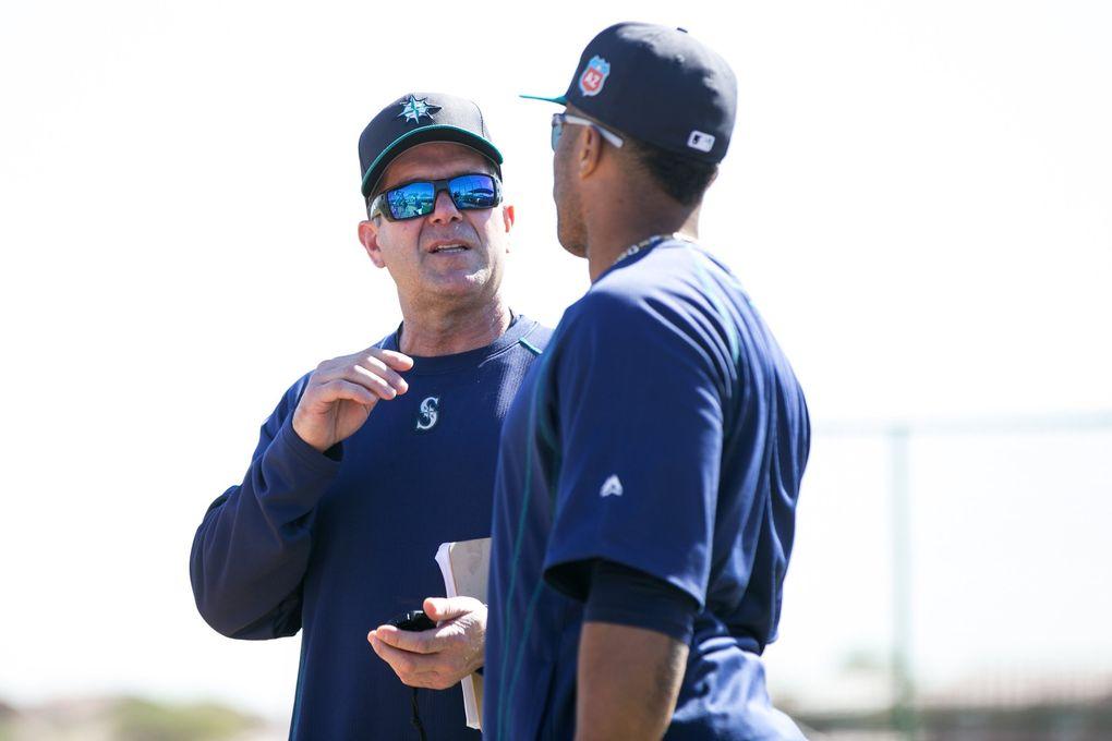 Mariners hitting coach Edgar Martinez talks with Robinson Cano at spring training Feb. 25 in Peoria, Ariz. (Bettina Hansen / The Seattle Times)