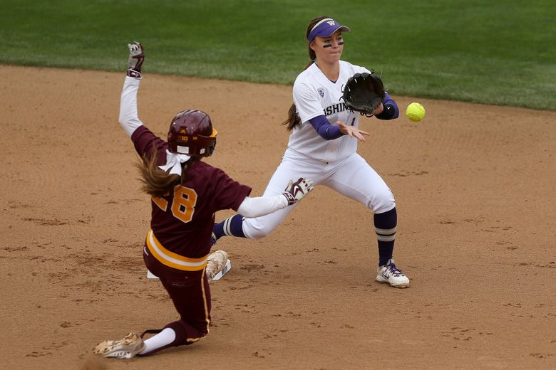 Washington Huskies shortstop Ali Aguilar (right) forces out Danielle Parlich (left) of the Minnesota Golden Gophers during the first inning of their NCAA regional playoff tournament matchup on Saturday. (Johnny Andrews / The Seattle Times)
