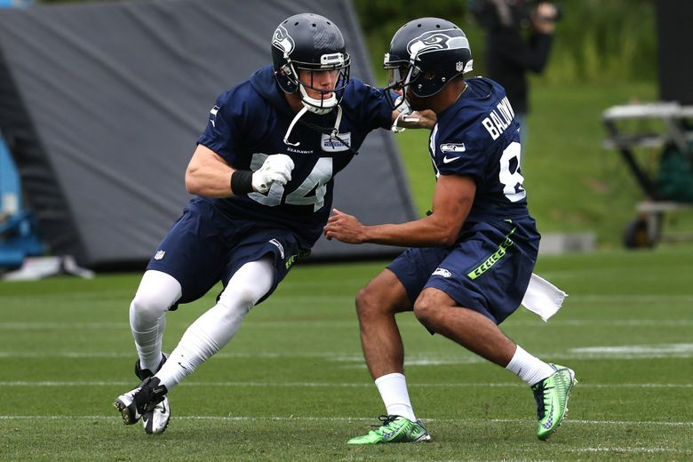 Seattle Seahawks tight end Cooper Helfet (left) works against wide receiver Doug Baldwin during organized team activities held on Thursday. (Johnny Andrews / The Seattle Times)