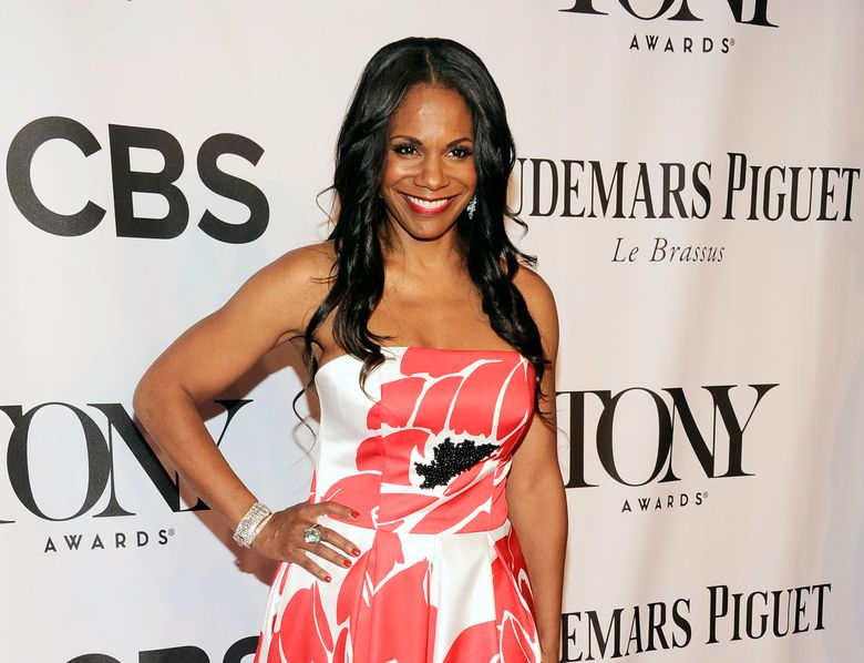 """FILE – In this June 8, 2014 file photo, actress Audra McDonald arrives at the 68th annual Tony Awards in New York.  McDonald on Tuesday, May 10, 2016,  announced she is expecting and will take maternity leave from """"Shuffle Along"""" beginning on July 24. She will return to the Tony Award-nominated musical this winter.  (Photo by Charles Sykes/Invision/AP, File)"""